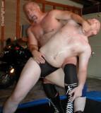 bikers fighting garage wrestling.jpeg