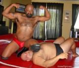 black wrestler beating down white fat bearish guy.jpg