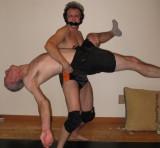 collegiate wrestling dude beating up older man.jpg