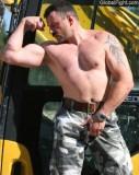 construction musclemen flexing big biceps.jpg