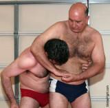 daddy bear wrestling son versus father rassling.jpg
