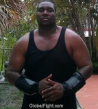 huge black wrestler muscle man powerlifter strong men.jpg
