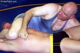 older hot men wrestling pec pounding punching.jpg