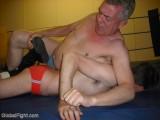 older man wrestling younger boy events.jpg