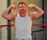 burly tanktop rugged beefy gay wrestler man dad.jpg