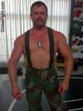 gear fetish military army fatigues gay man muscle hunk.jpg