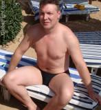 hot uk british daddy man swimming pool sun bathing.jpg