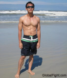 oriental muscle man jock walking swimming beach ocean.jpg