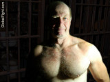 caged man captured older silver daddie bear muscleman.jpg