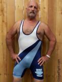moustached hairychest daddy bear wrestler wearing singlet.jpg
