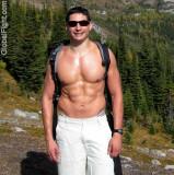 muscleman hiking climbing mountain shirtless nice abs.jpg