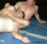 choking older stocky heavyset man pro wrestling bears.jpg