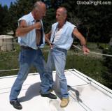 cowboys home built pro wrestling ring gut punching.jpg