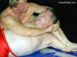 studly boy dominating older daddy bear wrestling match.jpg