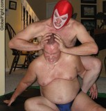 wrestling gay daddy bears head squeezing tortured man.jpg