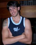 handsome dorm jock stud wearing tanktop posing gay bar.jpg