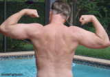 daddies flexing poolside showing off muscles daddy bear hunk.jpg