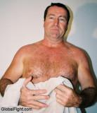 daddy drying off beach man toweling himself boating men swimming.jpg