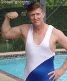hot hubby posing wrestling singlet flexing biceps daddy poolside.jpg
