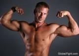 barechested muscle hunk flexing big arms shirtless gay jock.jpg
