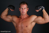 huge thick biceps muscles man flexing massive strong arms bodybuilder.jpg