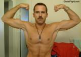 italian double biceps flexing new york NYC gay man.jpg