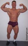 monster bodybuilder large man trapezius traps triceps muscles.jpg
