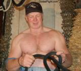 navy rodeo man tieing rope tiedup barn working hard.jpg