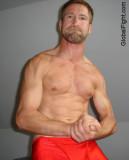 torn shirt fighting hot wrestler boy muscle jock hunk.jpg