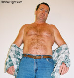 man torn shirt fighting wrestling ripped removing clothing daddy.jpg
