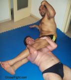 heavyset stocky pro wrestling men camels sleepers scissors.jpg