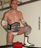 tough young wrestling buck sitting on turnbuckles.jpg