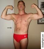 dorm room jock flexing muscular arms big biceps.jpg