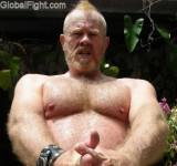 thick hairy pecs arms redhead leather man mohawk.jpg