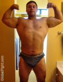 bodybuilder daddy flexing bathroom mirror self photos.jpg