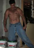 construction man sheet rocking plastering shirtless.jpg