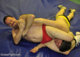 man wrestling neck vice head squeezing.jpg