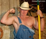 big cowboy working barn sweating shirtless hunky.jpg