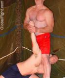 brother dad son fighting backyard garage wrestling.jpg