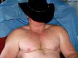 cowboy sleeping ranch worker resting huge chest.jpg