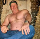 big irish cowboy daddy wearing jeans working barn.jpeg
