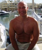 boating sailing daddy sitting sailboating shirtless.jpg
