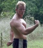 blond muscleboy outside flexing biceps hunky guy.jpg