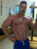 bearded muscleman daddy bear locker room gym.jpg
