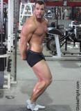 gay bodybuilder powerlifter posing flexing muscles.jpg