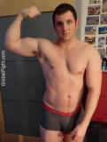 italian hot muscleman flexing biceps.jpg