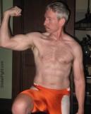 wrestler wearing spandex shorts flexing arms.jpg
