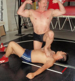 wrestler man humiliating opponent stepping on him.jpg
