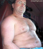 trucker shirtless sitting in cab beefy hairy belly.jpg