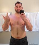bad assed bearded cub jock wrestler shooting finger.jpg